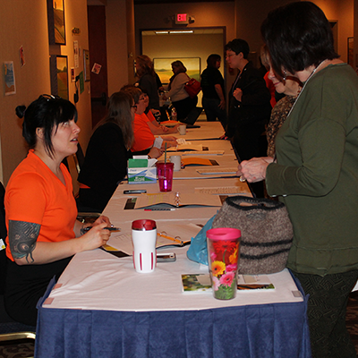 Winter State 2016: DD03 Jessy works the credentials table