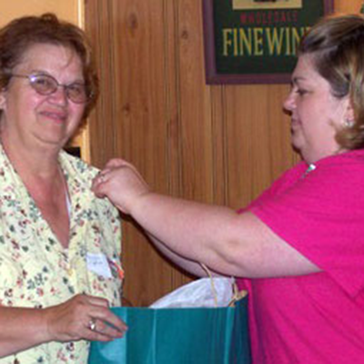 District 2: Mary Ann Johnson receiving Past DD Pin